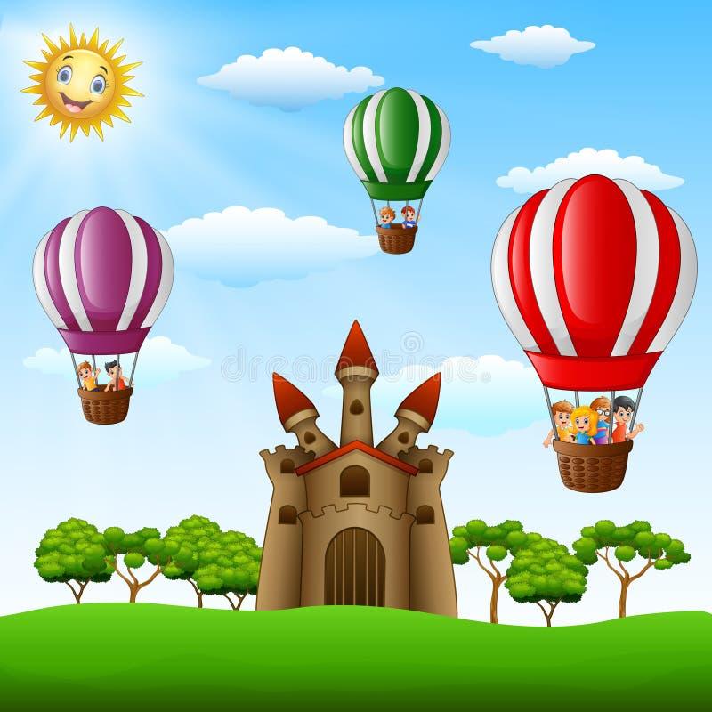 Beeldverhaaljonge geitjes die in een hete luchtballon dichtbij het kasteel berijden vector illustratie