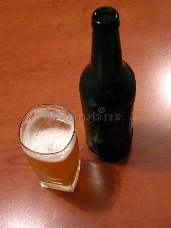 Download Beer stock photo. Image of contains, yelllow, botle, table - 662