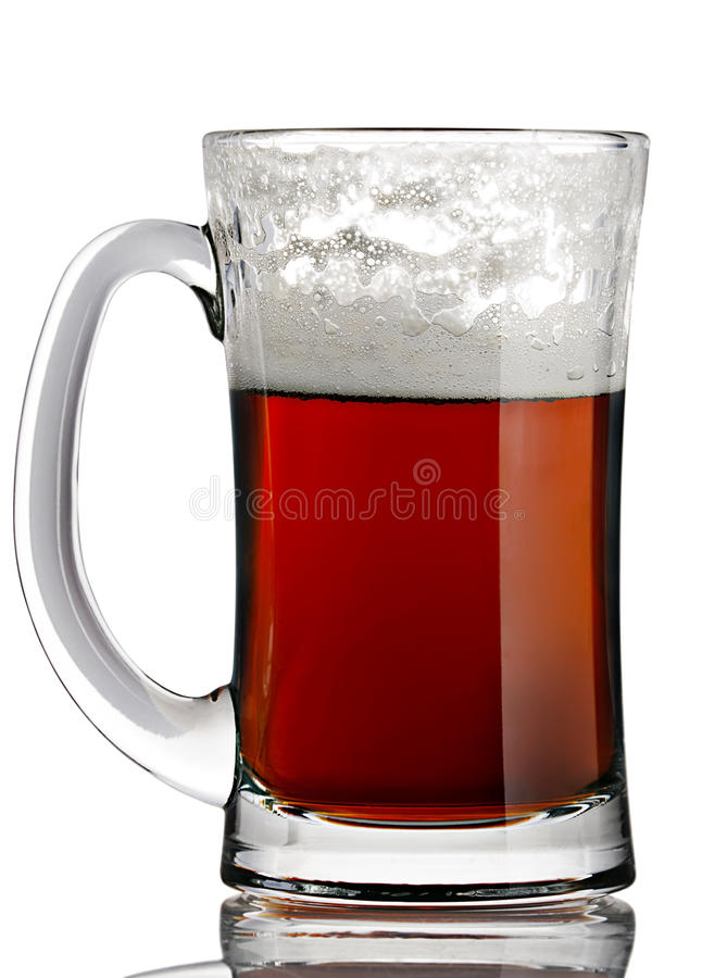Beer. Porter beer closeup in glass with handle on white stock images
