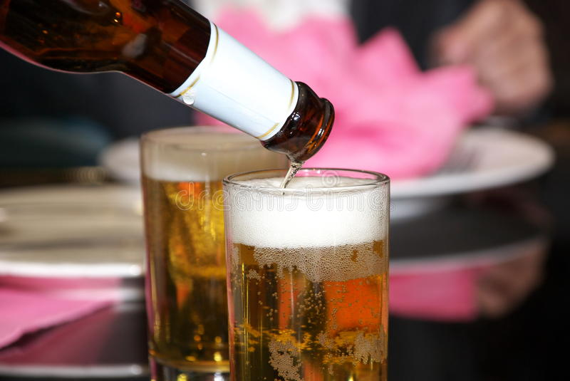 Download Beer stock photo. Image of pouring, beverage, restaurant - 12414984