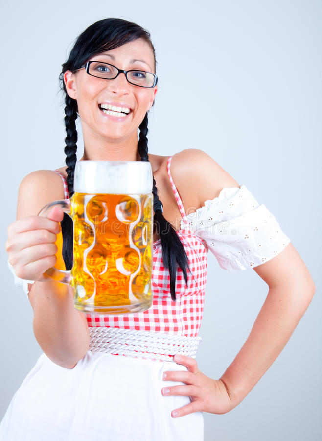 Beer. Smiling serving woman in dirndl stock photos
