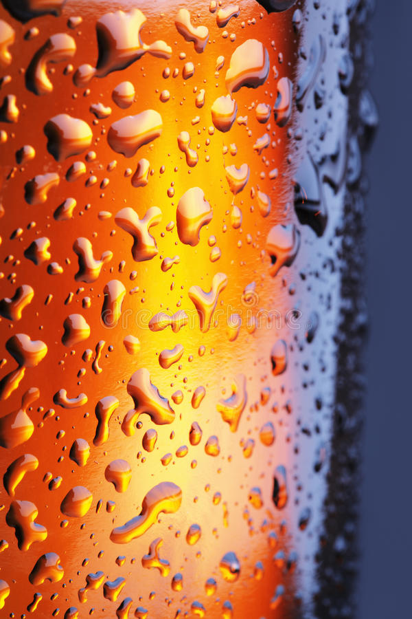 Beer. A Brown beer bottle with water beads in closeup royalty free stock photography