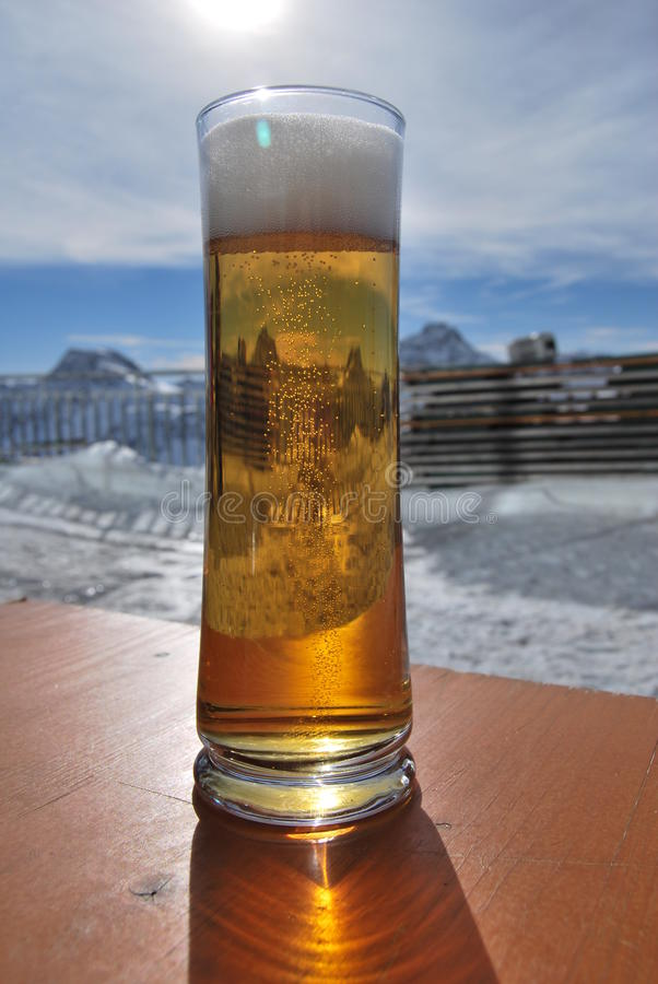 Beer. The alps seen through a pint of beer royalty free stock photo