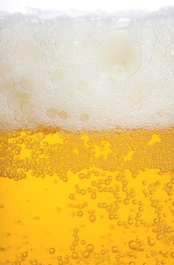 Beer. Mug of beer as background royalty free stock photo