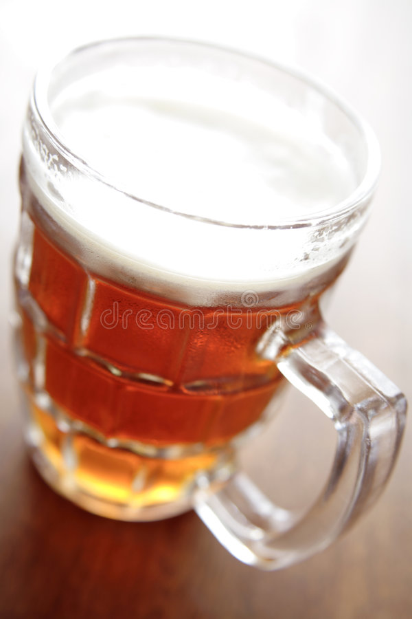 Beer. Pint of beer in glass stock images