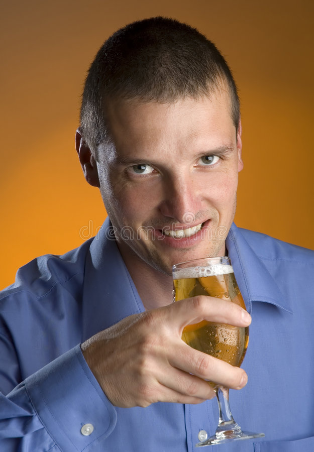 Beer. Young business men drinking cold beer portrait stock photos