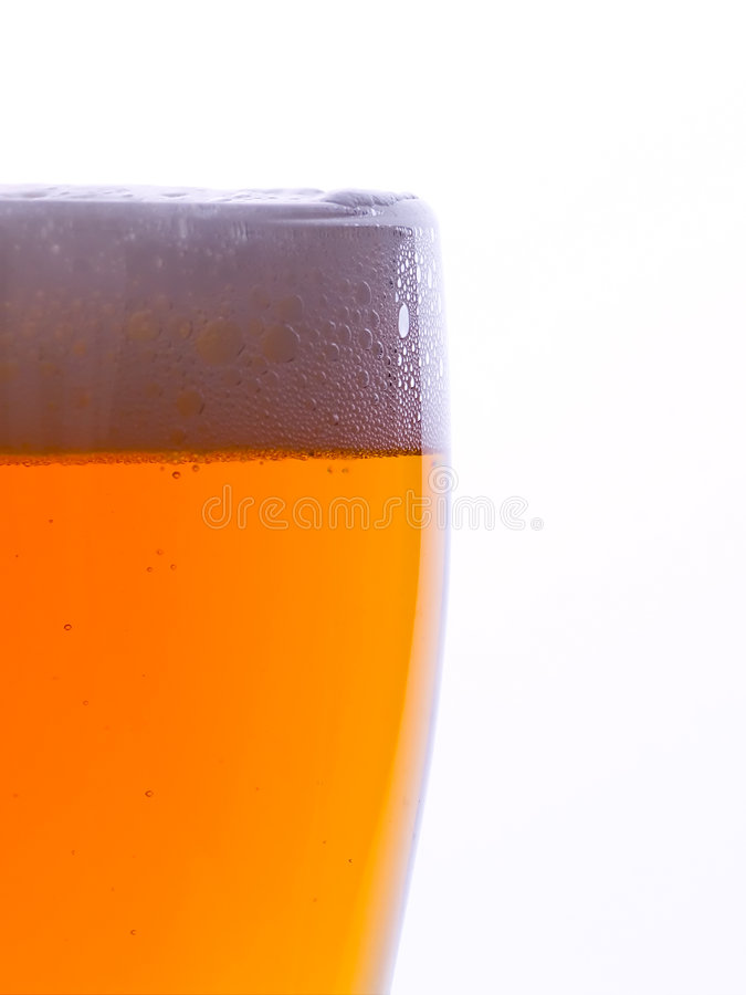 Beer. Close up glass of beer with foam royalty free stock photos