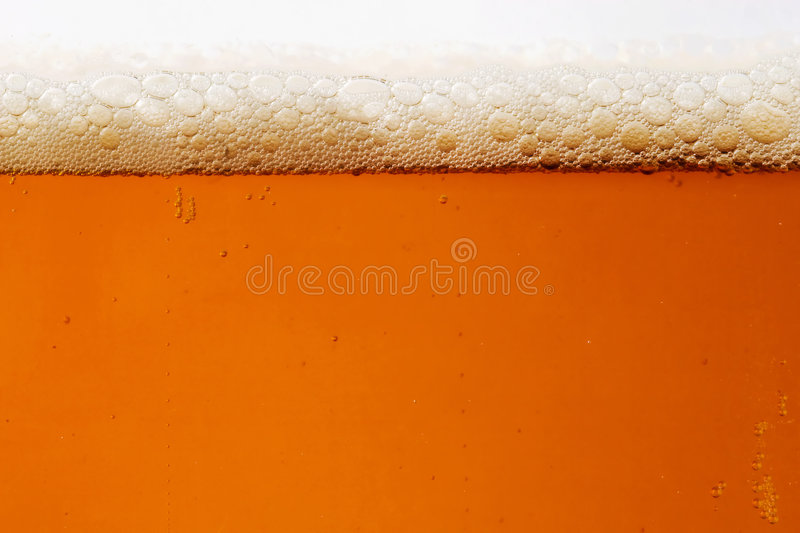 Beer. Close-up of a beer glass with amber-colored beer and bubbles