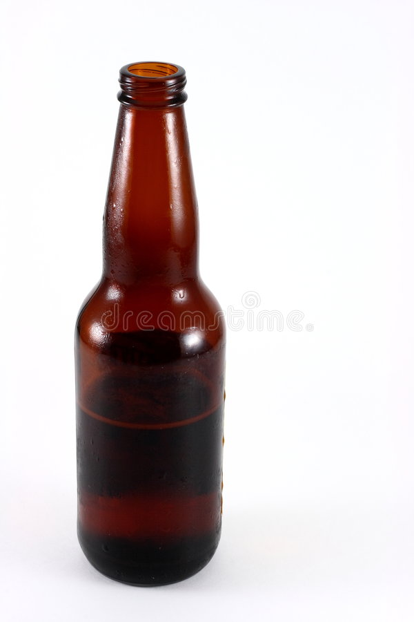 Brown Glass Beer Bottle Half Empty royalty free stock photography