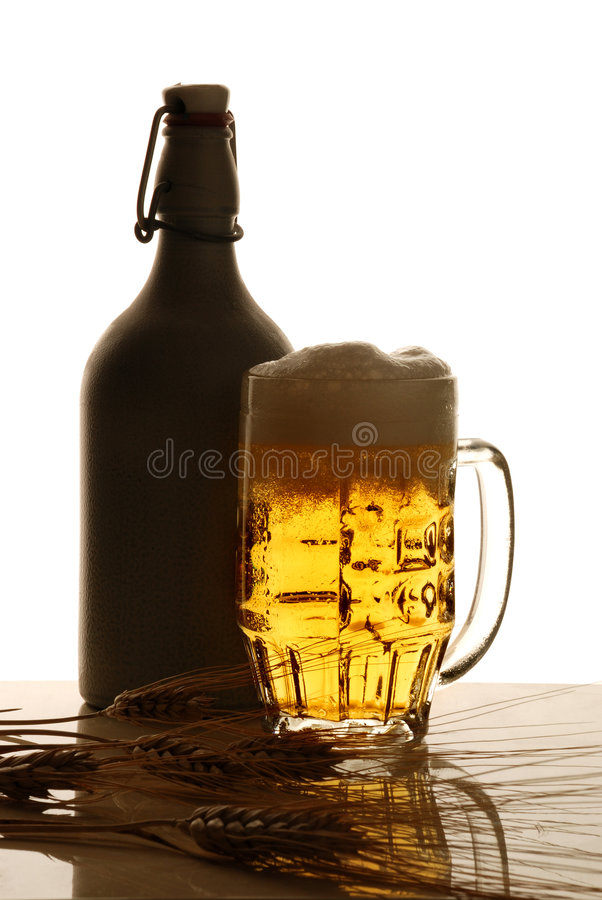 Beer. Bottle of beer mug with ears back stock images