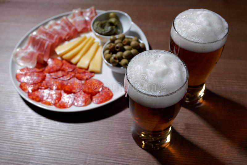 Beer and antipasto. On a table royalty free stock photo