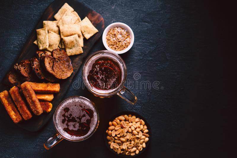 Beer and appetizers set. bar, restaurant, pub food. Beer and snacks. bar table. restaurant, pub, food concept. delicious lager drink and appetizers set- toasts royalty free stock images