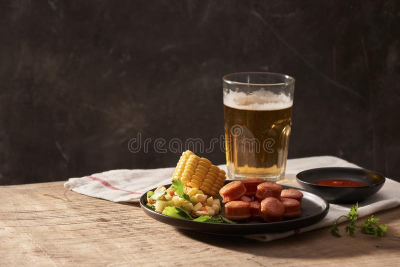 Beer and appetizing beer snacks set. Table with mug beer grilled royalty free stock photos