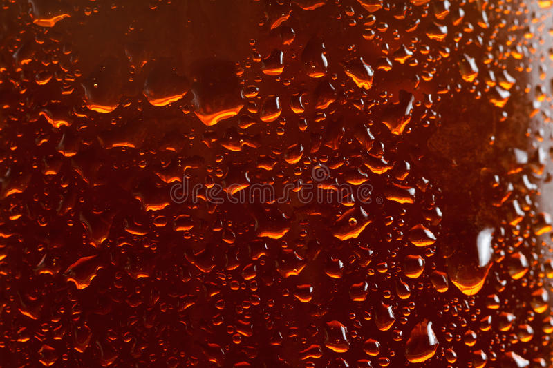 Beer background, macro flowing drops on the glass stock images