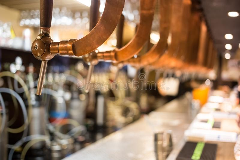 Beer bar pub tap, counter with blur pub background. Brussel Belgium.  stock photos