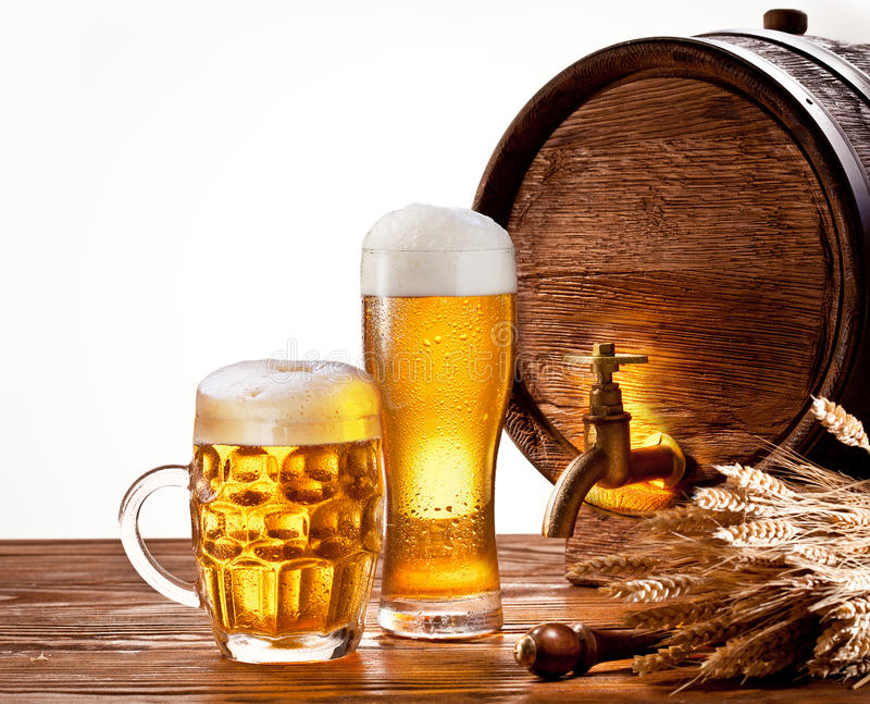 Beer barrel with beer glasses stock photography