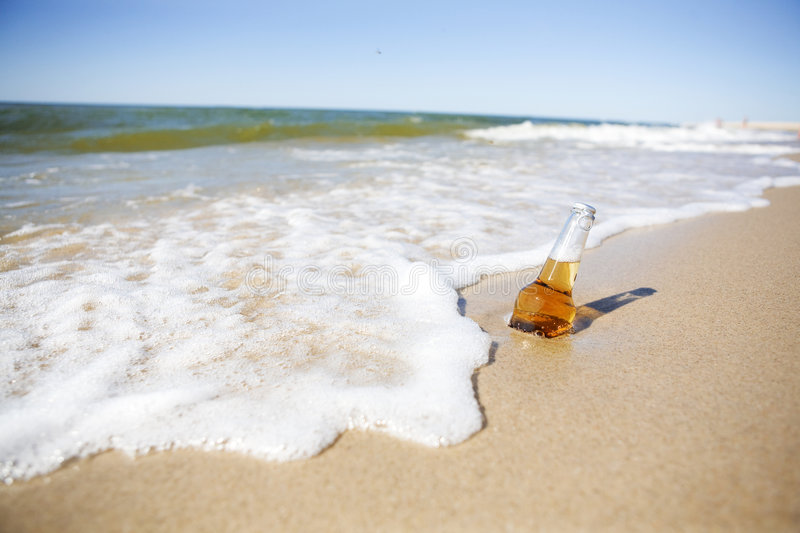 Beer on a Beach royalty free stock image