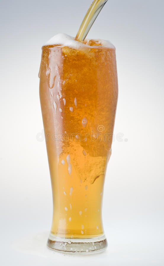 Beer being poured into a glass royalty free stock photography