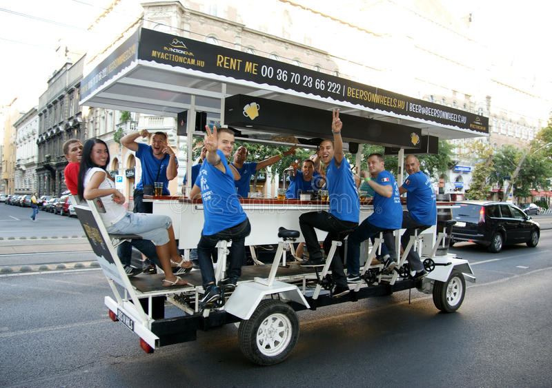Beer bike pub. With this tour tourists can see the hotspots of Budapest and drink beer stock photography