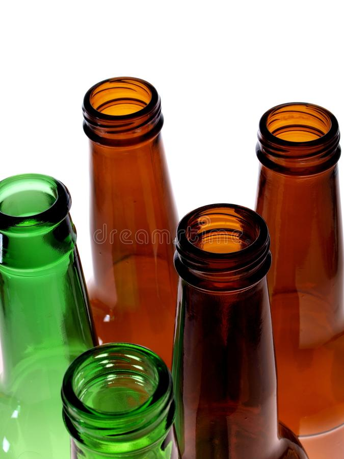 Beer Bottle Abstract Background Design. Abstract background design made up of different colored empty beer bottles stock photo