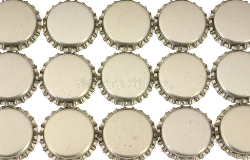 Beer bottle caps. Several beer bottle caps for use in home beer making royalty free stock images