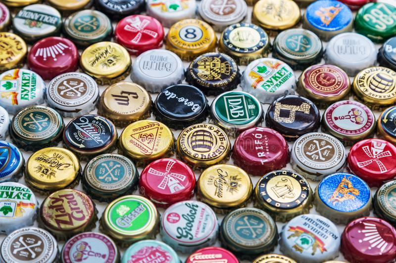 beer bottle caps background, mix of different world brands royalty free stock images
