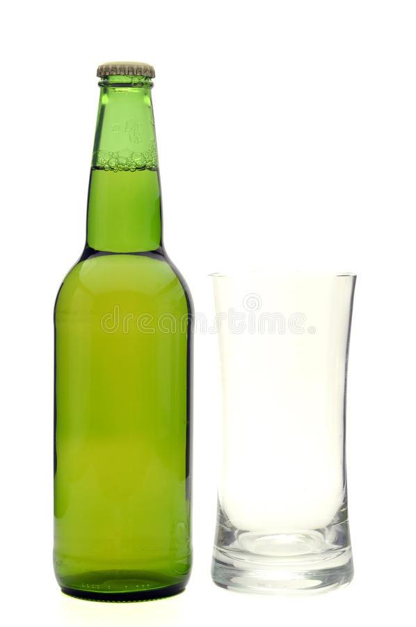 Beer bottle and empty glass stock photo