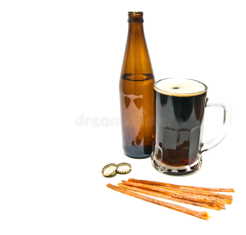 Beer, bottle and fish snack royalty free stock photo