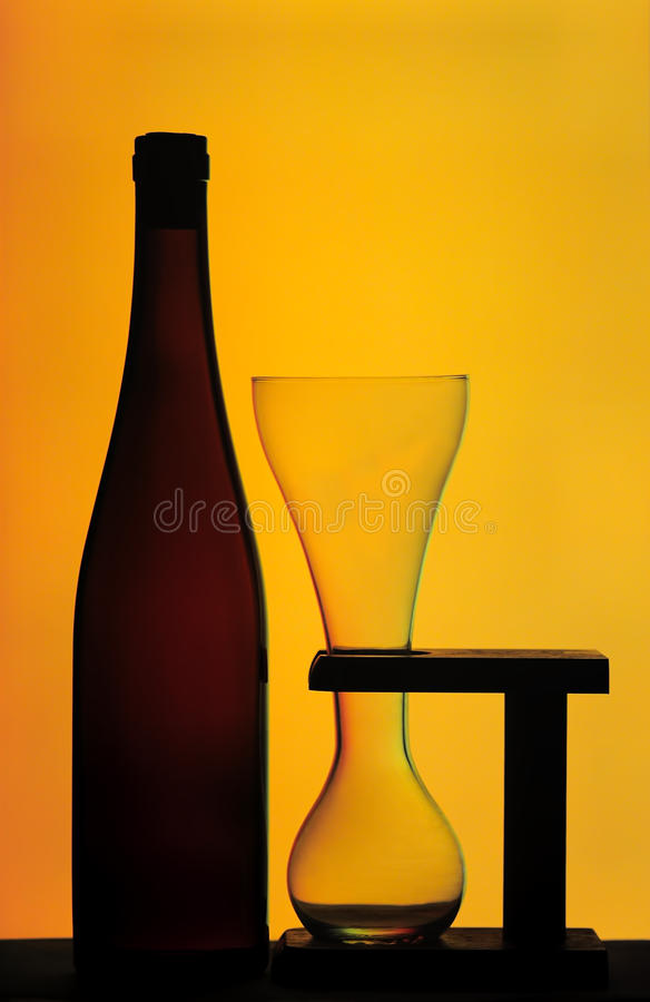 Beer Bottle And Glass On Wooden Stand Royalty Free Stock Images