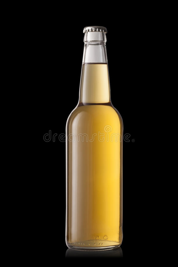 Beer bottle, isolated on a black background royalty free stock photos