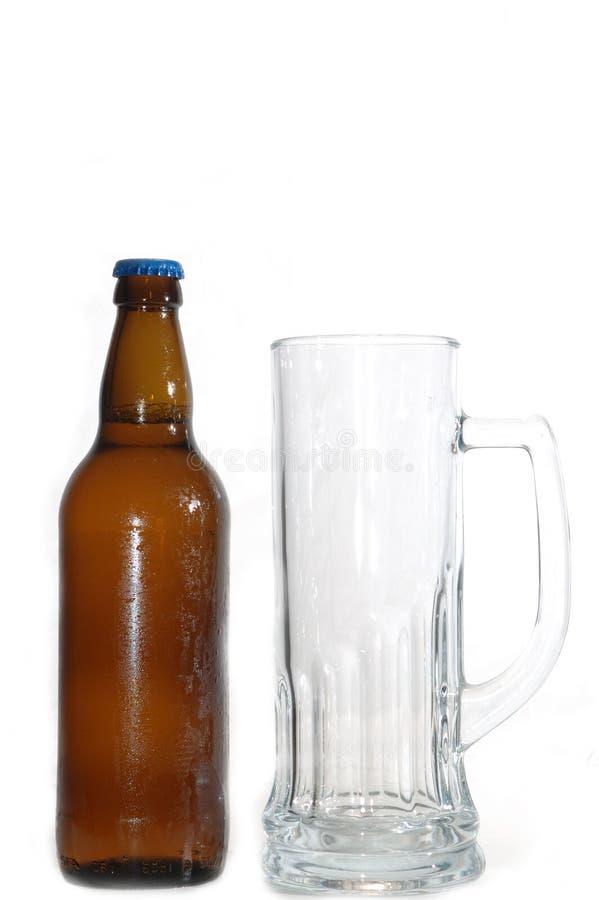 Beer bottle and mug stock photo