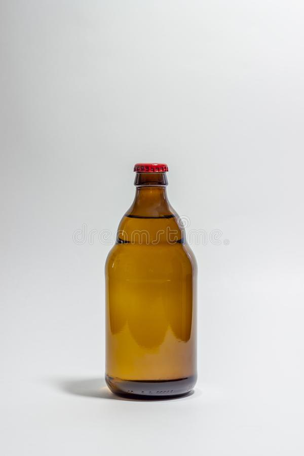 Beer bottle with a red cork on a gray background. Design. Minimalism. Creative idea. Mock-up stock images