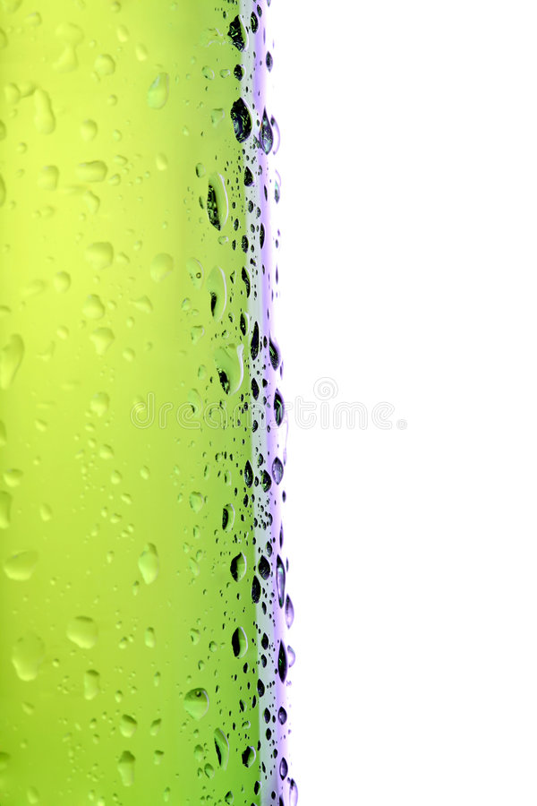 Beer bottle side macro isolated. Beer bottle side view, macro with water droplets isolated on white royalty free stock photos