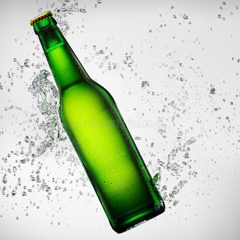 Beer bottle under water royalty free stock photos