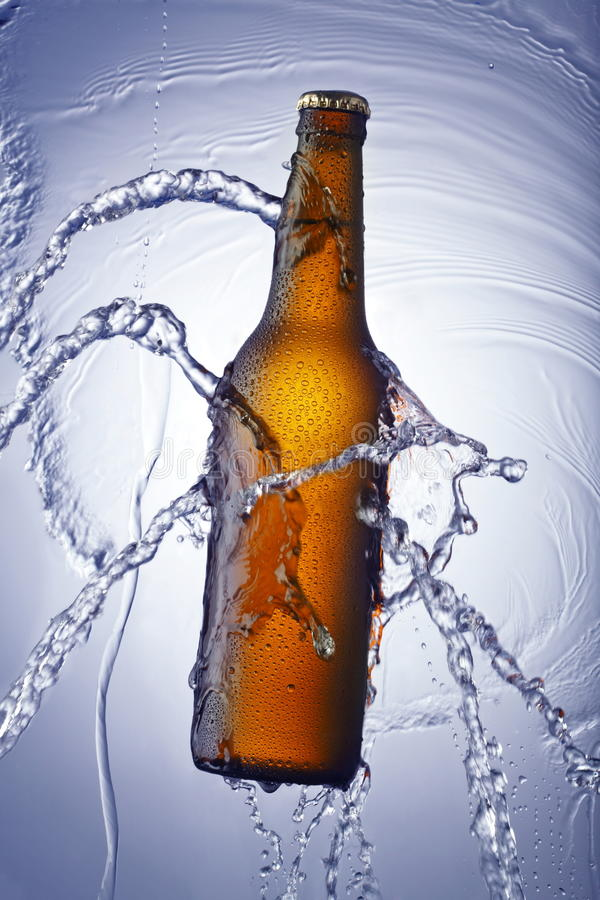 Beer bottle and water rinsing royalty free stock images