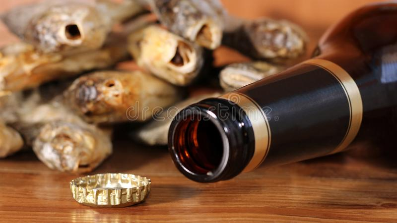 Beer bottle on a wooden table. Russian snack . Beer and dried fish. stock photography