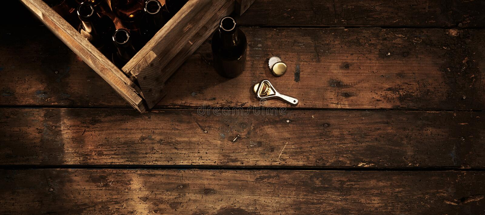 Beer bottles in a crate in a rustic pub or tavern stock photography
