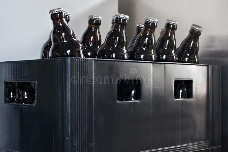 Beer bottles in an old plastic box. stock images
