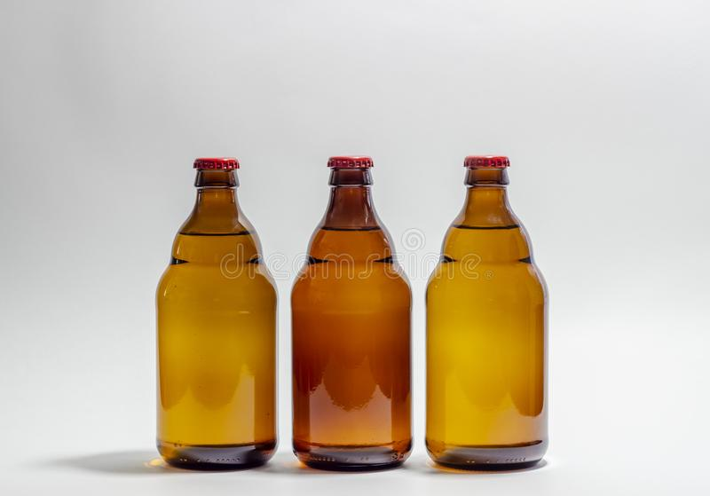 Beer bottles with a red cork on a gray background. Design. Minimalism. Creative idea. Mock-up royalty free stock photo