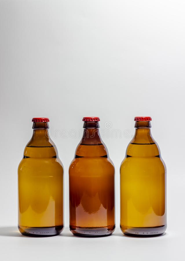 Beer bottles with a red cork on a gray background. Design. Minimalism. Creative idea. Mock-up. Drink, lager, glass, beverage, brown, ale, clean, blank stock photo
