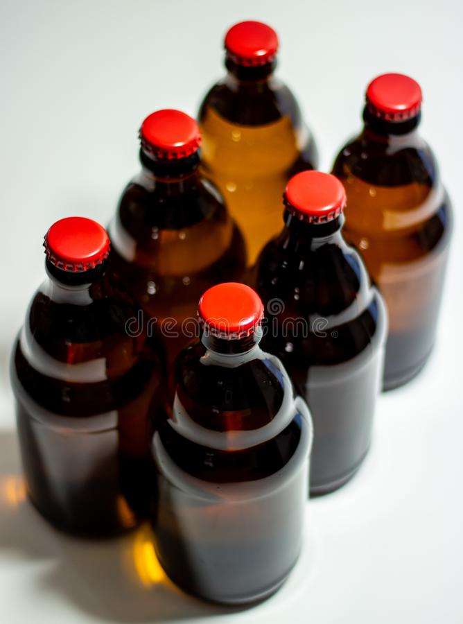 Beer bottles with a red cork on a gray background. Top view. Design. Minimalism. Creative idea. Mock-up stock photos