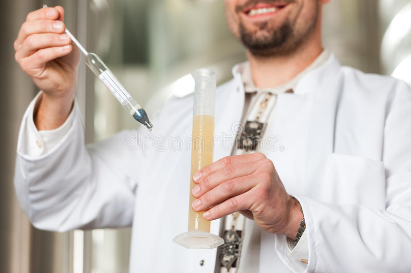 Download Beer Brewer In His Brewery Examining Stock Photo - Image: 25531968