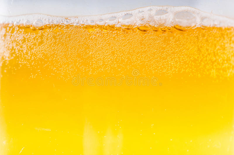 Beer bubbles in the high magnification and close-up. An image of beer bubbles in the high magnification and close-up stock photography