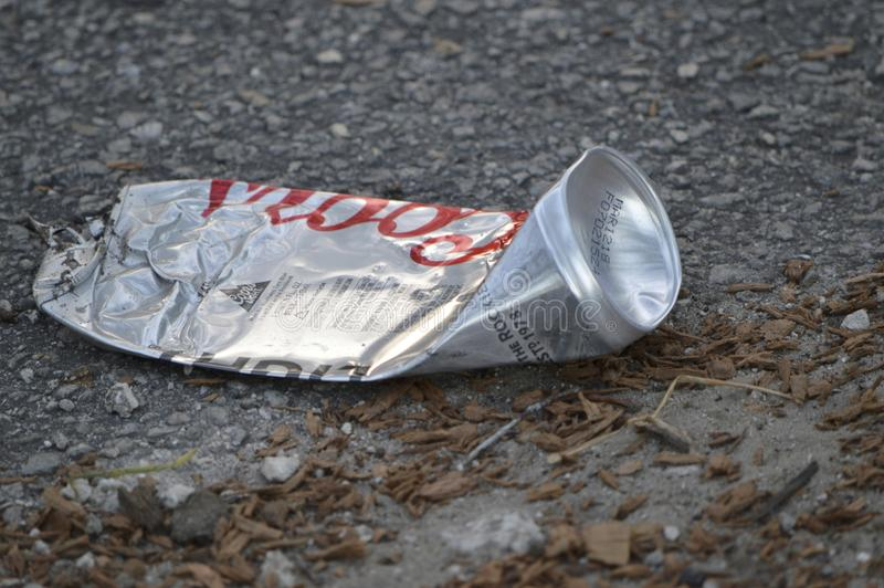 A beer can found on a side of the street royalty free stock image