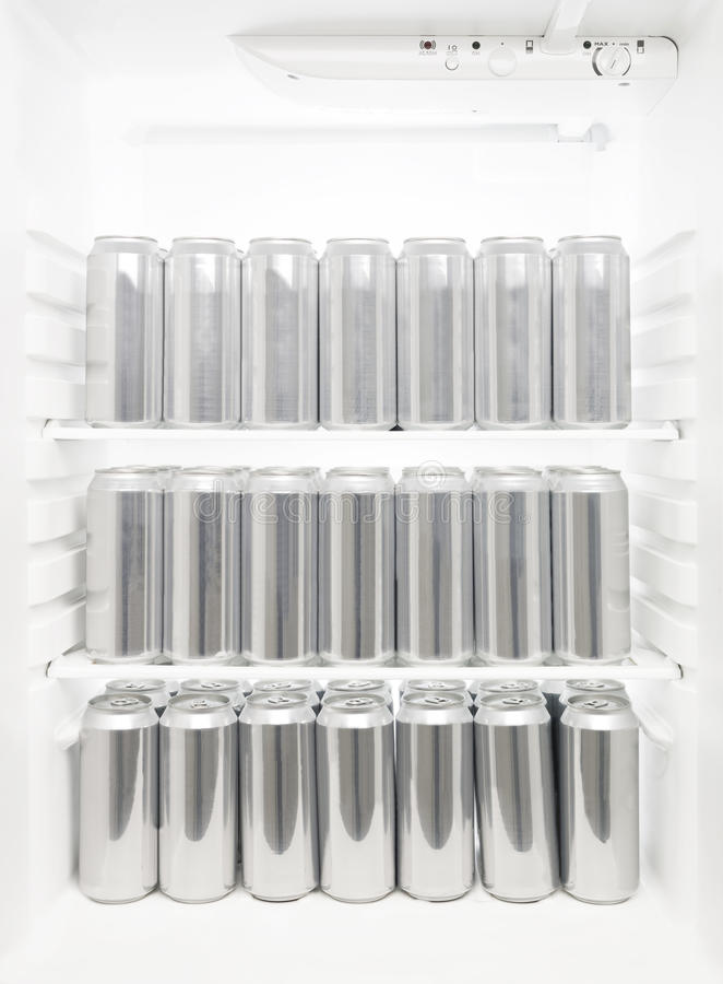 Beer cans in a Refrigerator stock photos