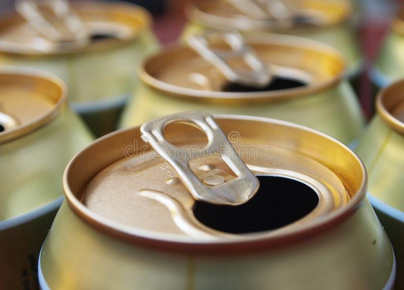 Beer cans. Some golden, metal beer cans stock photos