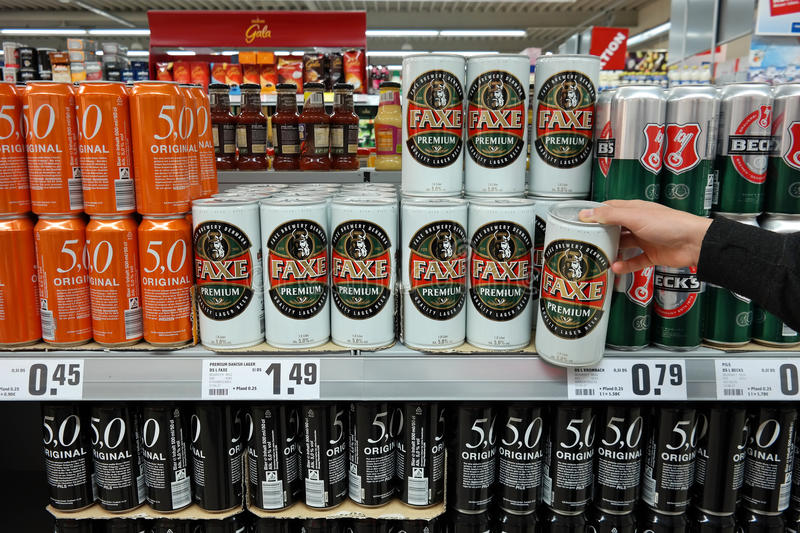 Beer cans in a supermarket stock image