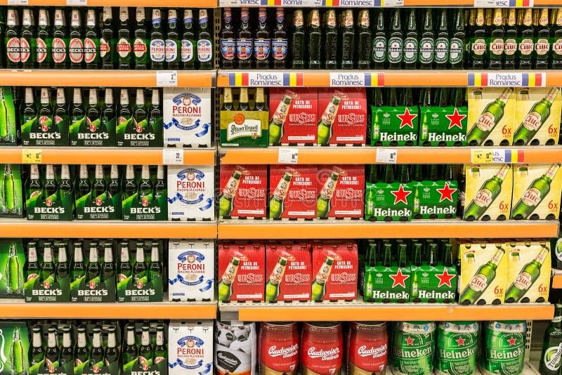 Beer Cans On Supermarket Shelf stock image