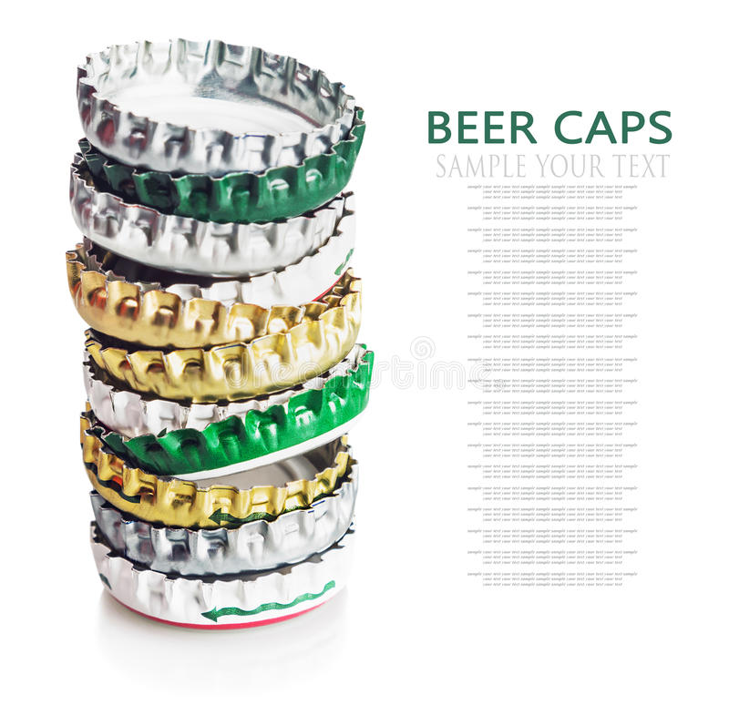 Beer cap isolated on white background. Focus is on the bottom of the frame stock photography