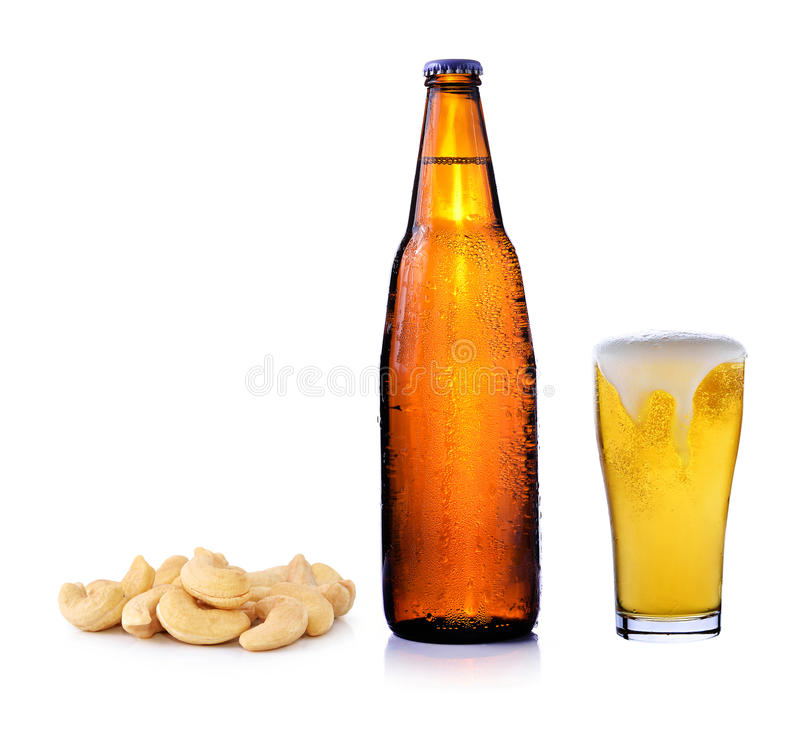 Beer and cashew nuts royalty free stock images